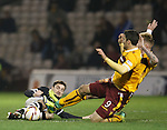 Paul Paton about to feel the force aof two Motherwell boots