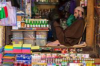 Fes, Morocco.  Shopkeeper in the Medina, Tala'a Kabira Street.