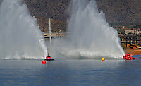 Nov. 22, 2008; Chandler, AZ, USA; IHBA top fuel hydro driver John Haas (left) races Glen Wilson during qualifying for the Napa Auto Parts World Finals at Firebird Lake. Mandatory Credit: Mark J. Rebilas-