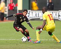 San Francisco, California - Saturday March 17, 2012: Javier Aquino and Ibrahima Yigo Ba in action during the Mexico vs Senegal U23 in final Olympic qualifying tuneup. Mexico defeated Senegal 2-1