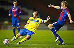 Inverness Caley Thistle v St Johnstone....28.03.12   SPL.Jody Morris clears from Richie Foran.Picture by Graeme Hart..Copyright Perthshire Picture Agency.Tel: 01738 623350  Mobile: 07990 594431