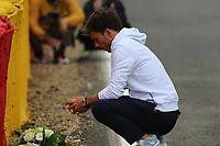 26th August 2021; Spa Francorchamps, Stavelot, Belgium: FIA F1 Grand Prix of Belgium, driver arrival day:   Pierre Gasly FRA 10 , Scuderia AlphaTauri Honda places a bouquet of flowers at the scene of the fatal accident of Anthoine Hubert