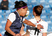 US's Sydney Leroux heads the ball next Germany's Anja Mittag during their Algarve Women's Cup soccer match at Algarve stadium in Faro, March 13, 2013.  .Paulo Cordeiro/ISI