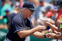 Scranton/Wilkes-Barre RailRiders bullpen coach Doug Davis (15) signs autographs for fans before a game against the Syracuse Chiefs on June 17, 2018 at NBT Bank Stadium in Syracuse, New York.  Syracuse defeated Scranton/Wilkes-Barre 4-2.  (Mike Janes/Four Seam Images)