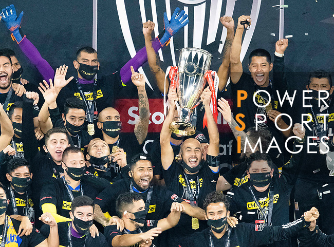 Players of Tigres UANL (MEX) celebrates with the championship trophy after winning their CONCACAF Champions League Final match against Los Angeles FC (USA) at the Orlando's Exploria Stadium on 22 December 2020, in Florida, USA. Photo by Victor Fraile / Power Sport Images