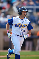 Wilmington Blue Rocks right fielder Roman Collins (34) runs to first base after hitting a home run during the first game of a doubleheader against the Frederick Keys on May 14, 2017 at Daniel S. Frawley Stadium in Wilmington, Delaware.  Wilmington defeated Frederick 10-2.  (Mike Janes/Four Seam Images)
