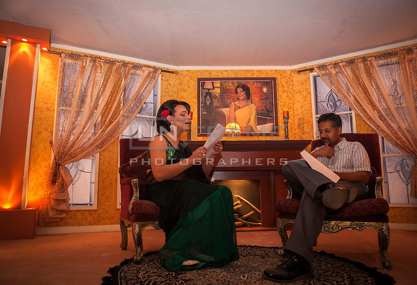 Saleem / Begum has a last review to the script with the director on the set before the recording.