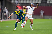 KASHIMA, JAPAN - JULY 27: Steph Catley #7 of Australia and Lynn Williams #21 of USA battle for a ball before a game between Australia and USWNT at Ibaraki Kashima Stadium on July 27, 2021 in Kashima, Japan.