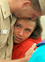 X.marinesDeploy.1.0822.jl.jpg/photo lytle/Naval YNCCS Dan Burke of San Diego cries as he hugs his crying daughter Chelsea age 11, defore being deployed to the gulf  for 8 months on the USS Peleliu (LHA 5) Thursday in San Diego.