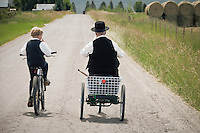 Mennonite grandfather and grandchild returning home after Sunday services.