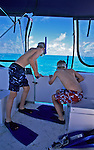 Two young boys can't wait to get in the water and snorkel off Andros, Bahamas