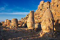 Pictures of the statues of around the tomb of Commagene King Antochus 1 on the top of Mount Nemrut, Turkey. Stock photos & Photo art prints. In 62 BC, King Antiochus I Theos of Commagene built on the mountain top a tomb-sanctuary flanked by huge statues (8–9 m/26–30 ft high) of himself, two lions, two eagles and various Greek, Armenian, and Iranian gods. The photos show the broken statues on the  2,134 m (7,001 ft)  mountain. 1