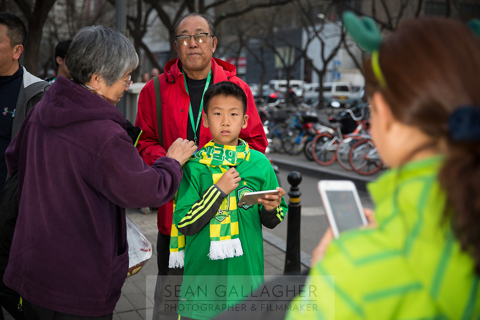 Fans of Chinese Super League football team Beijing Guo'an wait outside the Worker's Stadium in Beijing before their team's game with Shanghai Shenhua. 2nd April, 2017.