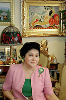 Imelda Marcos former first lady of the Philippines portrait in her apartment in Manila in 2006, Philippines, note the original Picasso painting on the wall behind her, a rare event interviews are seldom granted in her private residence