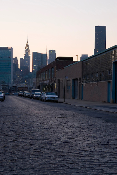 Chrysler Building and Midtown Manhattan Skyline at Dusk, Viewed from Cobblestone Street in an Industrial Neighborhood of Hunters Point, Queens, New York City, New York State