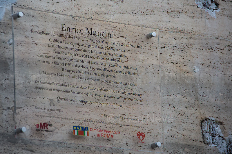 Plaque in Memory of Enrico Mancini and the 335 Victims of the Fosse Ardeatine Massacre.<br /> <br /> Rome, Italy. 24th Mar, 2021. Today, Citizens of Rome, Antifascists, various organizations, Institutions and the President of the Italian Republic, Sergio Mattarella, pay tribute to the victims of the Fosse Ardeatine massacre in which, 77 years ago, on the 24th March 1944, 335 people were assassinated by the nazi-fascist occupation troupes in Rome. It was one of the most atrocious massacre perpetrated during World War II for retaliation against the Resistance and the Civilians.    <br /> <br /> Footnotes & Links:<br /> (Source, Treccani.it ITA) http://bit.do/fPZXL <br /> (Source, Jewishvirtuallibrary.org ENG) http://bit.do/fPZXu<br /> (Source, Wikipedia.org ENG) http://bit.do/fPZXW <br /> Today's Events: https://www.facebook.com/events/4526526500707783/ & https://www.facebook.com/events/1096587897511737/