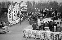 race leader Tom Meeusen (BEL/Telenet-Fidea) coming from the river (Rupel) banks onto the industrial site the race course goes through<br /> <br /> Jaarmarktcross Niel 2015  Elite Men & U23 race