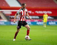 31st October 2020; Bramall Lane, Sheffield, Yorkshire, England; English Premier League Football, Sheffield United versus Manchester City; Chris Basham of Sheffield United on the ball looking for a pass forward