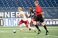 FOXBOROUGH, MA - OCTOBER 16: Thomas Roberts #23 of North Texas SC brings the ball forward during a game between North Texas SC and New England Revolution II at Gillette Stadium on October 16, 2020 in Foxborough, Massachusetts.
