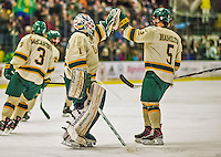 4 January 2014:  University of Vermont Catamount Goaltender Mike Santaguida, a Freshman from Mississauga, Ontario, gets a high-five from Number 5, Defenseman Rob Hamilton, a Freshman from Calgary, Alberta, celebrating a first period goal against the Yale University Bulldogs at Gutterson Fieldhouse in Burlington, Vermont. With an empty net and seconds remaining, the Cats came back to tie the game 3-3 against the 10th seeded Bulldogs. Mandatory Credit: Ed Wolfstein Photo *** RAW (NEF) Image File Available ***