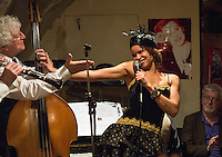 Bernard Brimeur (double bass) and Nicolle Rochelle (vocal) at a jazz concert by the Fantastic Harlem Drivers at the Petit Journal St Michel, Paris, Saturday 19th April 2014. The Fantastic Harlem Drivers consist of pianist Lou Lauprete, clarinetist Alain Marquet, double bass player Bernard Brimeur, and vocalists Sylvia Howard and Nicolle Rochelle, accompanied by tap-dancers Jelly Germain, his son Osiris Germain and Caroline Podetti. Lou Lauprete and Alain Marquet are regulars at Paris Boogie Speakeasy, the  private Parisian jazz club founded and run by Yves Riquet. Sylvia Howard sings with the Duke Ellington orchestra and the Black Label Swingtet, each led by saxophone player Christian Bonnet. Nicolle Rochelle is an internationally known singer, dancer, and actress, the star of Jerome Savary's 'Josephine' which ran for four years in France and Europe, in which Nicolle took the lead role as Josephine Baker. The evening was also attended by Yves Riquet (Sponsor and founder of Paris Boogie Speakeasy) and Jean-Paul Amouroux introduced as the finest player of Boogie-Woogie in Europe. The Fantastic Harlem Drivers were recently recorded for a new CD at Paris Boogie Speakeasy, 256 Rue Marcadet, Paris. Saturday 19th April 2014.