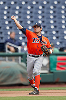 Cal State Fullerton third baseman Jerrod Bravo (12) warms up before the NCAA College baseball World Series against the Vanderbilt Commodores Titans on June 15, 2015 at TD Ameritrade Park in Omaha, Nebraska. Vanderbilt beat Cal State Fullerton 4-3. (Andrew Woolley/Four Seam Images)