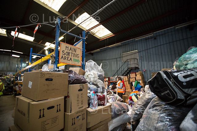 """Main Warehouse """"L'Auberge"""" where donations - including food - are managed and then distributed to the camps. <br /> <br /> Under the Sky of Calais & Dunkirk. Two Camps, Two Sides of the Same Coin: Not 'migrants', Not 'refugees', just Humans.<br /> <br /> France, 24-30/03/2016. Documenting (and following) Zekra and her experience in the two French camps at the gate of the United Kingdom: Calais' """"Jungle"""" and Dunkirk's """"Grande-Synthe"""". Zekra lives in London but she is originally from Basra in Iraq. Zekra and her family had to flee Kuwait - where they moved for working reason - due to the """"Gulf War"""", and to the Western Countries' will to """"export Democracy in Iraq"""". Zekra is a self-motivated volunteer and founder of """"Happy Ravers"""", a group of people (not a NGO or a charity) linked to each other because of their love for rave parties but also men and women who meet up every week to help homeless people and other people in need in Central London. (Here there are some of the stories I covered about Zekra and """"Happy Ravers"""": http://bit.ly/1XVj1Cg & http://bit.ly/24kcGQz & http://bit.ly/1TY0dPO). Zekra worked as an English teacher in the adult school at Dunkirk's """"Grande-Synthe"""" camp and as a cultural mediator and Arabic translator for two medic teams in Calais' """"Jungle"""". Please read her story at the beginning of this reportage."""