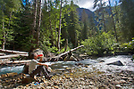 Little Beaver Creek, hiker drinking, purifying water, North Cascades National Park, wilderness, Ross Lake National Recreation Area, Cascade Mountains, Washington State,.Pacific Northwest,