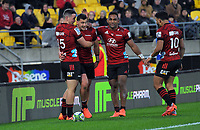 The Crusaders congratulate David Havili on his late try during the Super Rugby Aotearoa match between the Hurricanes and Crusaders at Sky Stadium in Wellington, New Zealand on Saturday, 21 June 2020. Photo: Dave Lintott / lintottphoto.co.nz
