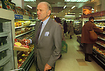 Lord Sieff Marks and Spencers Oxford Street store London 1980s / 1990s . Checking product in store. Lord Sieff was chairman of M&S