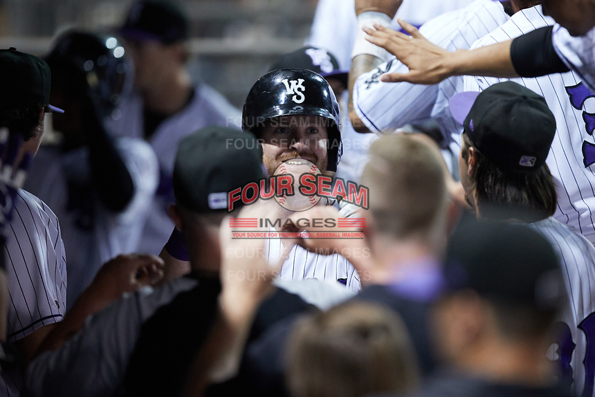 Alex Destino (23) of the Winston-Salem Dash is congratulated by teammates after hitting a home run against the Hickory Crawdads at Truist Stadium on July 10, 2021 in Winston-Salem, North Carolina. (Brian Westerholt/Four Seam Images)