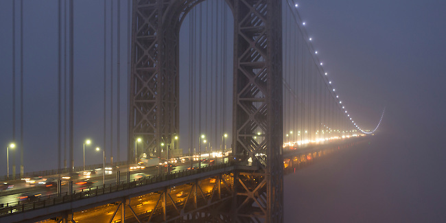 NYC's George Washington Bridge disappears in a heavy winter fog.