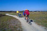 Family cycling on Gravel Path, Boundary Bay Regional Park, Delta, BC, British Columbia, Canada