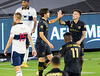 LOS ANGELES, CA - SEPTEMBER 23: Brian Rodriguez #17 of the Los Angeles football club celebrates a goal with team mate Francisco Ginella #8 during a game between Vancouver Whitecaps and Los Angeles FC at Banc of California Stadium on September 23, 2020 in Los Angeles, California.