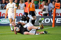 20130802 Copyright onEdition 2013 ©<br /> Free for editorial use image, please credit: onEdition.<br /> <br /> Tom Catterick of Newcastle Falcons 7s scores a try during the J.P. Morgan Asset Management Premiership Rugby 7s Series.<br /> <br /> The J.P. Morgan Asset Management Premiership Rugby 7s Series kicks off for the fourth season on Thursday 1st August with Pool A at Kingsholm, Gloucester with Pool B being played at Franklin's Gardens, Northampton on Friday 2nd August, Pool C at Allianz Park, Saracens home ground, on Saturday 3rd August and the Final being played at The Recreation Ground, Bath on Friday 9th August. The innovative tournament, which involves all 12 Premiership Rugby clubs, offers a fantastic platform for some of the country's finest young athletes to be exposed to the excitement, pressures and skills required to compete at an elite level.<br /> <br /> The 12 Premiership Rugby clubs are divided into three groups for the tournament, with the winner and runner up of each regional event going through to the Final. There are six games each evening, with each match consisting of two 7 minute halves with a 2 minute break at half time.<br /> <br /> For additional images please go to: http://www.w-w-i.com/jp_morgan_premiership_sevens/<br /> <br /> For press contacts contact: Beth Begg at brandRapport on D: +44 (0)20 7932 5813 M: +44 (0)7900 88231 E: BBegg@brand-rapport.com<br /> <br /> If you require a higher resolution image or you have any other onEdition photographic enquiries, please contact onEdition on 0845 900 2 900 or email info@onEdition.com<br /> This image is copyright the onEdition 2013©.<br /> <br /> This image has been supplied by onEdition and must be credited onEdition. The author is asserting his full Moral rights in relation to the publication of this image. Rights for onward transmission of any image or file is not granted or implied. Changing or deleting Copyright information is illegal as specified in the Copyright, Design and Patents