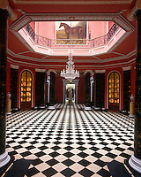 The monumental hall is an octagon with double pairs of Ionic columns painted to resemble green marble and a black and white marble floor