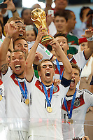 Philipp Lahm of Germany celebrates winning the FIFA World Cup by lifting the trophy with his team mates