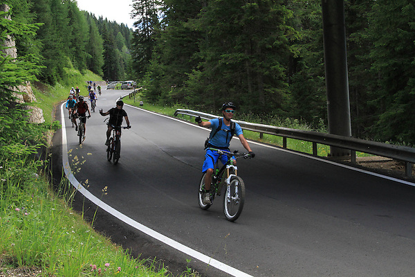 Cyclists in the Dolomites, Canazei, Italy, Europe. .  John offers private photo tours in Denver, Boulder and throughout Colorado, USA.  Year-round. .  John offers private photo tours in Denver, Boulder and throughout Colorado. Year-round.