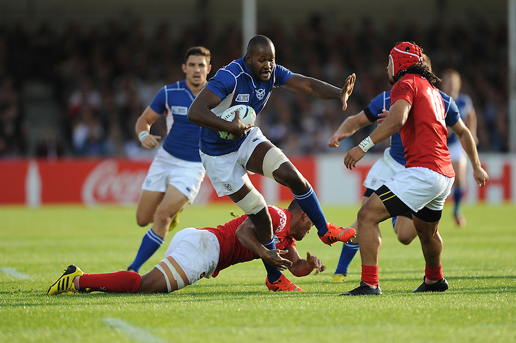 Tjiuee Uanivi of Namibia is tackled by Joseph Tuineau as Latiume Fosita of Tonga supports during Match 20 of the Rugby World Cup 2015 between Tonga and Namibia - 29/09/2015 - Sandy Park, Exeter<br /> Mandatory Credit: Rob Munro/Stewart Communications