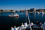 Victoria, BC inner harbor with fishing vessel passing behind the departing ferry M.V. Coho bound for Port Angeles, WA.
