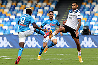 Victor Osimhen of SSC Napoli and Cristian Romero of Atalanta BC compete for the ball during the Serie A football match between SSC Napoli and Atalanta BC at San Paolo stadium in Naples (Italy), October 17th 2020. Photo Cesare Purini / Insidefoto