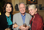 Jose DeGuzman, Jack Murphy and Susan Hilferty at a party featuring a performance of musical selections from Wonderland at the home of Lynn Wyatt Tuesday Jan. 12,2010.(Dave Rossman/For the Chronicle)