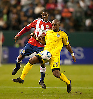 CARSON, CA – APRIL 9, 2011: Columbus Crew forward Emilio Renteria (20) shields the ball from a Chivas USA player during the match between Chivas USA and Columbus Crew at the Home Depot Center, April 9, 2011 in Carson, California. Final score Chivas USA 0, Columbus Crew 0.