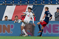 FOXBOROUGH, MA - JULY 23: Luca Petrasso #38 of Toronto FC II attempts to control the ball as Sean O'Hearn #40 of New England Revolution II pressures during a game between Toronto FC II and New England Revolution II at Gillette Stadium on July 23, 2021 in Foxborough, Massachusetts.