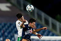 FOXBOROUGH, MA - AUGUST 26: Cesar Murillo #4 of Greenville Triumph SC and Nicolas Firmino #29 of New England Revolution II battle for head ball during a game between Greenville Triumph SC and New England Revolution II at Gillette Stadium on August 26, 2020 in Foxborough, Massachusetts.