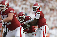 Arkansas quarterback KJ Jefferson (1) hands the ball off to running back Raheim Sanders (5), Saturday, September 11, 2021 during the first quarter of a football game at Reynolds Razorback Stadium in Fayetteville. Check out nwaonline.com/210912Daily/ for today's photo gallery. <br /> (NWA Democrat-Gazette/Charlie Kaijo)