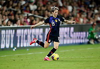 ORLANDO, FL - MARCH 05: Megan Rapinoe #15 of the United States turns with the ball during a game between England and USWNT at Exploria Stadium on March 05, 2020 in Orlando, Florida.