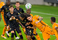 CARSON, CA - OCTOBER 28: Eddie Segura #4  of the Los Angeles FC battles with Zarek Valentin #4 of the Houston Dynamo for a head ball during a game between Houston Dynamo and Los Angeles FC at Banc of California Stadium on October 28, 2020 in Carson, California.