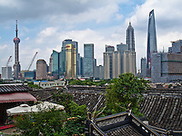Juxtaposition of the ancient roofs of Yu Gardens and Old Town with the Modern Cityscape of downtown Shanghai.