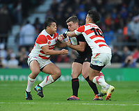 George Ford (c) of England is tackled by Atsushi Sakate and Yu Tamura of Japan during the Quilter International match between England and Japan at Twickenham Stadium on Saturday 17th November 2018 (Photo by Rob Munro/Stewart Communications)